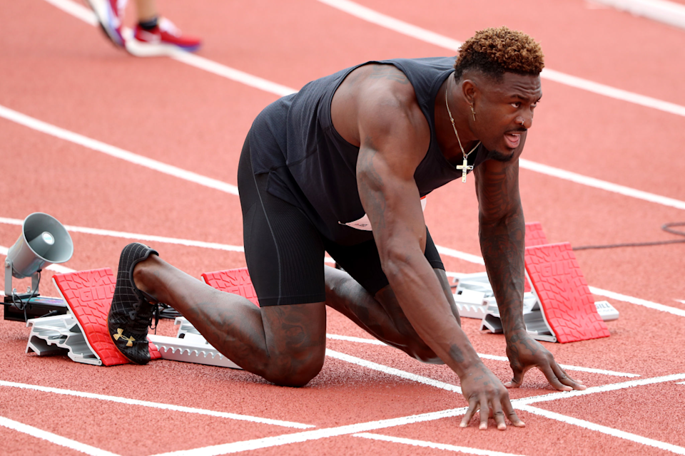 DK Metcalf warms up before competing in the men's 100-meter dash at the USATF Golden Games.