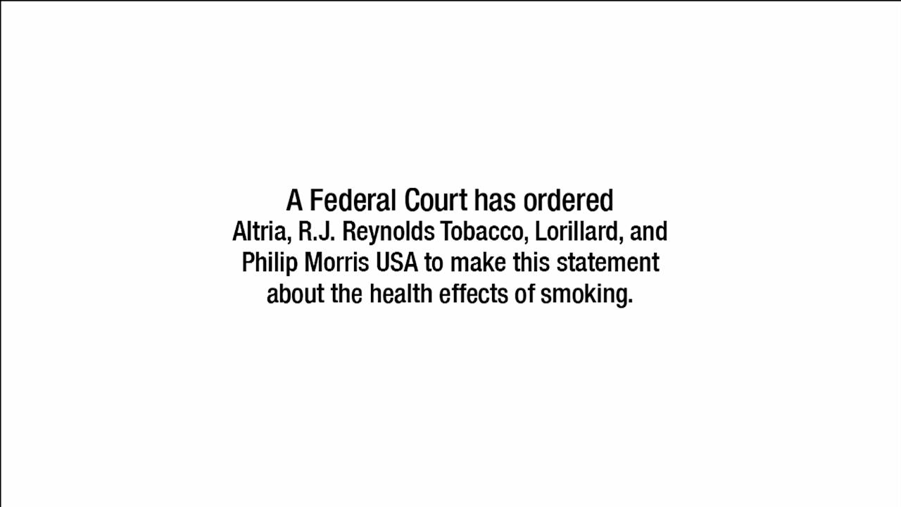 This undated photo shows a screen shot from a commercial that will air on television starting the week of Nov. 26. Under court order, the largest U.S. tobacco companies have to publicize the deadly, addictive effects of smoking, more than a decade after a judge ruled that the industry had misled the public about the risks of cigarettes, which continue to kill about a half-million Americans annually. The ads will run for 52 weeks. (U.S. Department of Justice via AP)