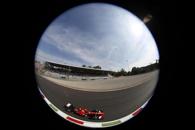 In this picture taken with a fish-eye lens, Ferrari driver Felipe Massa of Brazil steers his car on his way to clocking the fourth fastest time during the qualifying session for the Italian Formula One Grand Prix at the Monza racetrack, in Monza, Italy, Saturday, Sept. 7, 2013. The Formula one race will be held on Sunday. (AP Photo/Alessandro Trovati)