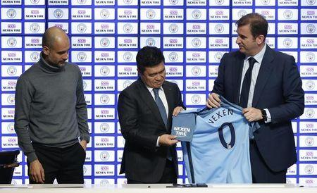 Manchester City manager Pep Guardiola, Nexen Tire CEO Travis Kang and chief executive Ferran Soriano during the announcement of a partnership with Nexen Tire