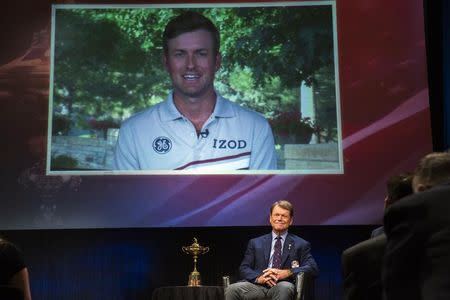 Ryder Cup team U.S. captain Tom Watson smiles as he announces that Webb Simpson (on screen) will be one of his three picks to add to this year's Ryder Cup squad during an event in New York September 2, 2014. REUTERS/Lucas Jackson