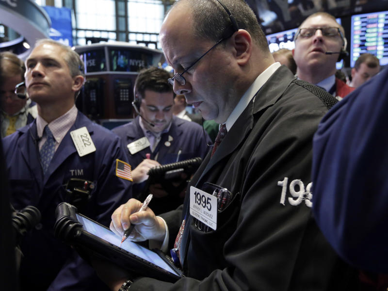 Traders work on the floor of the New York Stock Exchange Friday, April 19, 2013. The broad Standard & Poor's 500 index opened higher early Friday. (AP Photo/Richard Drew)