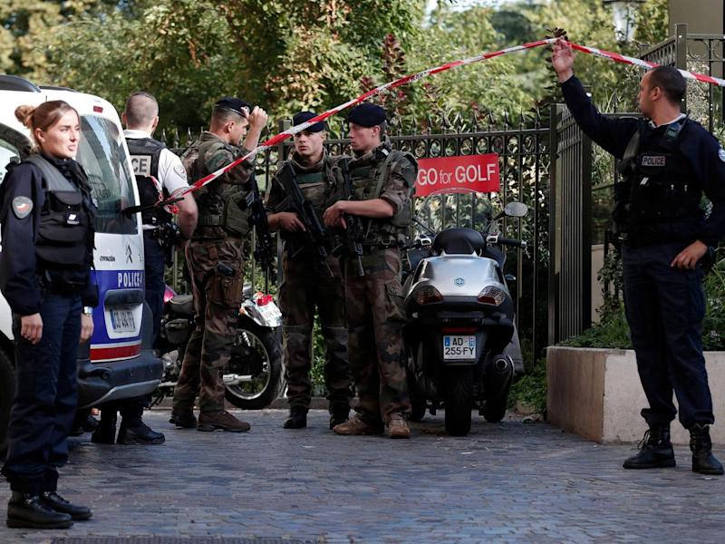 Police and soldiers secure the scene where French soliders were hit and injured by a vehicle in the western Paris suburb of Levallois-Perret (REUTERS/Benoit Tessier)