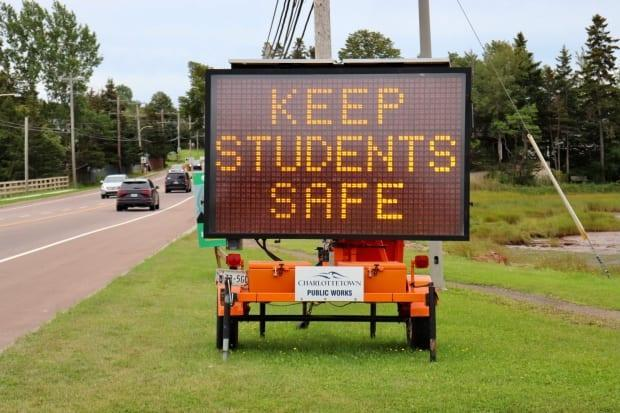Traffic sign in Charlottetown saying 'School Has Started, Drive with Care, Keep Students Safe.' (Jane Robertson/CBC - image credit)