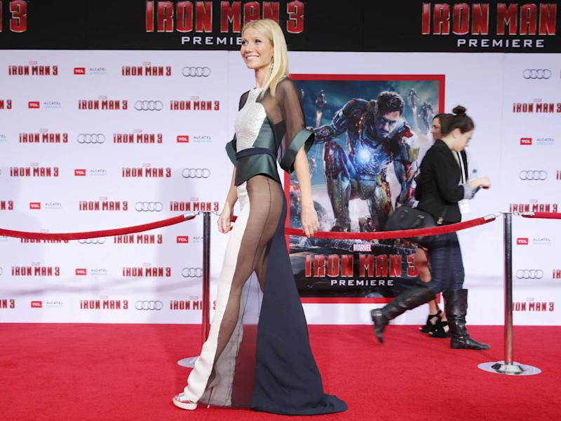 "This April 24, 2013 file photo shows actress Gwyneth Paltrow wearing a sheer dress at the world premiere of ""Iron Man 3"" held at the El Capitan Theatre in Los Angeles. Paltrow says she's thrilled to be picked by People magazine as ""World's Most Beautiful Woman"" for 2013 but it's ""obviously not true."" Paltrow questioned her own selection as she walked the red carpet at the Hollywood premiere of ""Iron Man 3"" Wednesday night. ""It's funny, these things, because it's like obviously not true. But it's very sweet to be named that,"" Paltrow told The Associated Press. The 40-year-old actress stars as Pepper Potts, Tony Stark's love interest and assistant-turned-business partner in the ""Iron Man"" trilogy. (Photo by Eric Carbonneau/Invision/AP)"