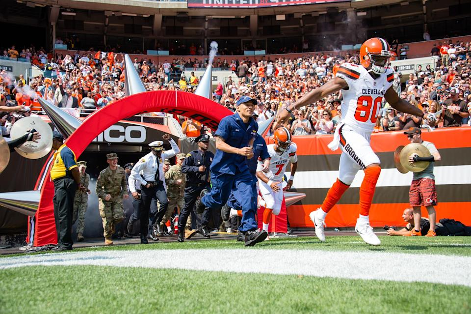 The Cleveland Browns ran out of their tunnel joined by police, firefighters and EMTs. (Photo by Jason Miller/Getty Images)