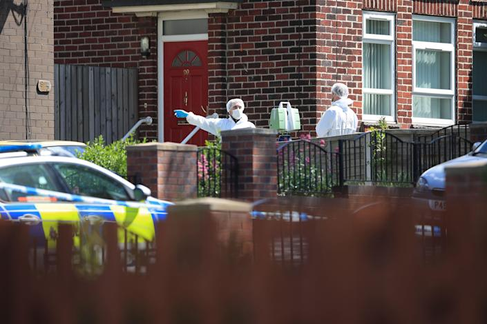 Forensics officers at a property on Gregg House Road in Shiregreen, Sheffield, on Friday (Picture: PA)