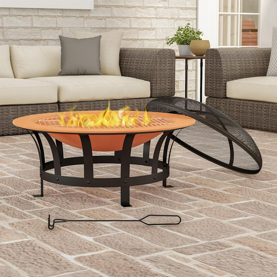 <p>Pull up a chair and enjoy a warm evening around this <span>Janzen Outdoor Deep Steel Wood Burning Fire Pit</span> ($123, originally $260).</p>
