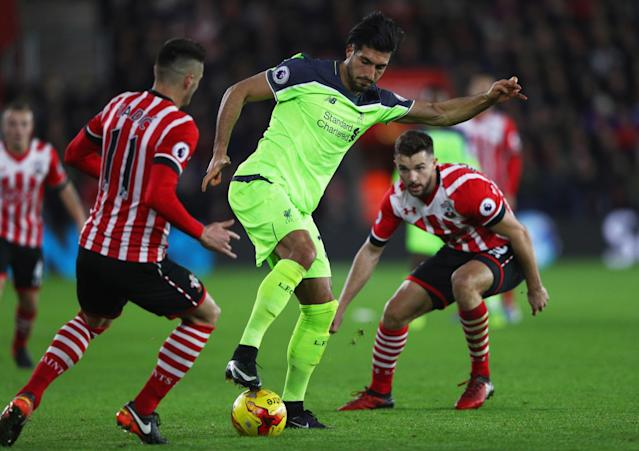 <p>Emre Can tries to wriggle out of a tight spot (Getty Images) </p>