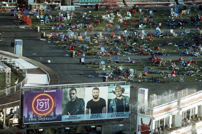 FILE - In this Oct. 3, 2017 file photo, personal belongings and debris litters the Route 91 Harvest festival grounds across the street from the Mandalay Bay resort and casino in Las Vegas. Tales of horror and heroism emerged Wednesday, May 23, 2018, in a new cache of documents made public by Las Vegas police about the investigation of the deadliest mass shooting in the nation's modern history. (AP Photo/Marcio Jose Sanchez, File)
