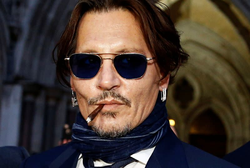 Actor Depp takes on UK tabloid in court battle over 'wife beater' claims