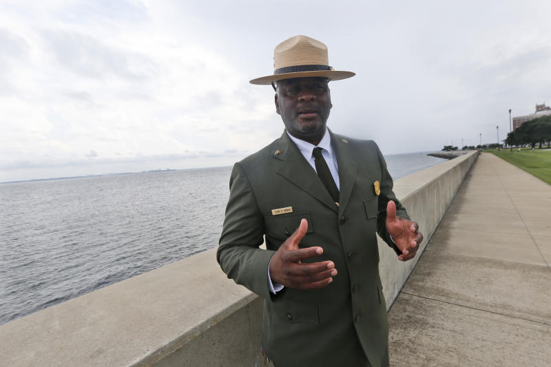 Terry E. Brown, Superintendent of the Fort Monroe National Monument gestures near the spot of the first landing of Africans in America 400 years ago at Fort Monroe in Hampton, Va., Thursday, Aug. 15, 2019. (AP Photo/Steve Helber)