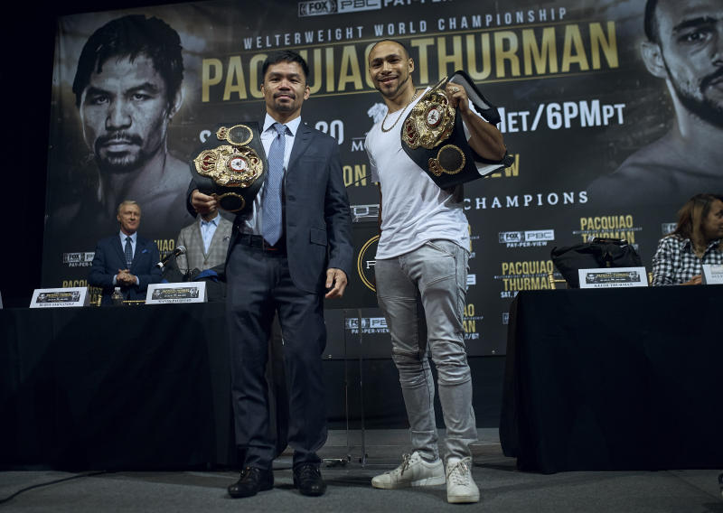 Manny Pacquiao, left, and Keith Thurman pose for a picture during a news conference on Tuesday, May 21, 2019, in New York. The two are scheduled to fight in a welterweight world championship boxing bout on Saturday, July 20, in Las Vegas. (AP Photo/Andres Kudacki)