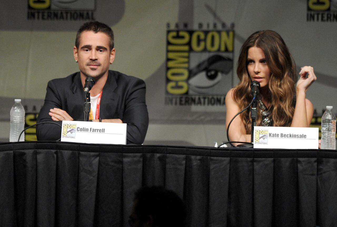 """SAN DIEGO, CA - JULY 13:  Actors Colin Farrell (L) and Kate Beckinsale speak during Sony's """"Total Recall"""" panel during Comic-Con International 2012 at San Diego Convention Center on July 13, 2012 in San Diego, California.  (Photo by Kevin Winter/Getty Images)"""