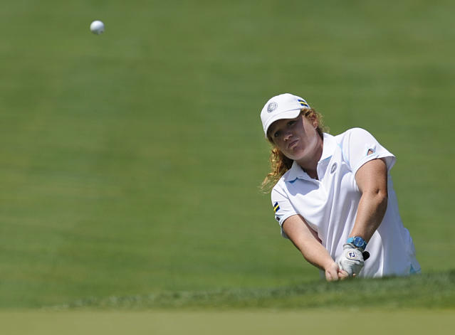 Mikaela Parmlid, of Sweden, chips onto the first hole during the third round of the International Crown golf tournament on Saturday, July 26, 2014, in Owings Mills, Md.(AP Photo/Gail Burton)