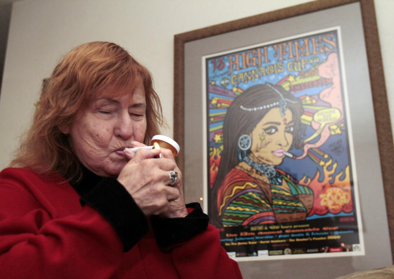 Elvy Musikka, 72, who suffers from glaucoma, lights a marijuana cigarette, one of many she regularly receives from the U.S. Government, at her home in Eugene, Ore., Tuesday, Sept. 27, 2011. For the past three decades, the federal government has been providing a handful of patients with some of the highest grade marijuana around. The program grew out of a 1976 court settlement that created the country's first legal pot smoker. (AP Photo/Don Ryan)