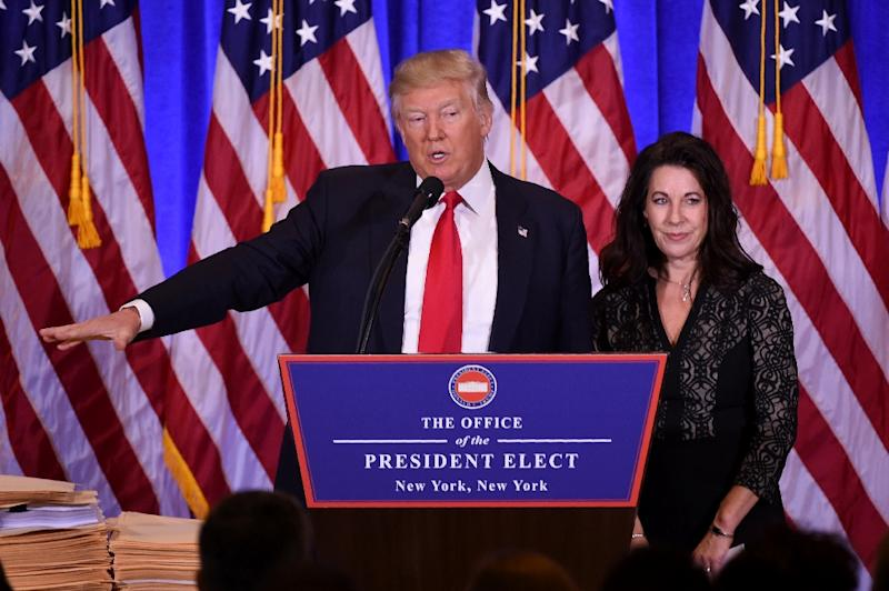 US President-elect Donald Trump gives a press conference with his Attorney Sheri Dillon (R) on January 11, 2017 in New York (AFP Photo/DON EMMERT)