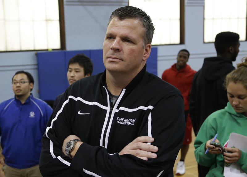 Creighton men's basketball coach Greg McDermott listens as his son, Doug McDermott, speak during an NCAA college basketball news conference in Omaha, Neb., Thursday, April 25, 2013. The All-America forward says he'll return to Creighton for his senior year instead of declaring for the NBA draft. (AP Photo/Nati Harnik)