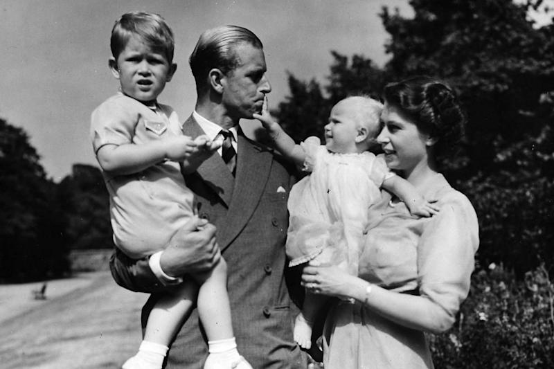The Queen stands with her husband Prince Philip in 1951 with Prince Charles and Princess Anne (AP)