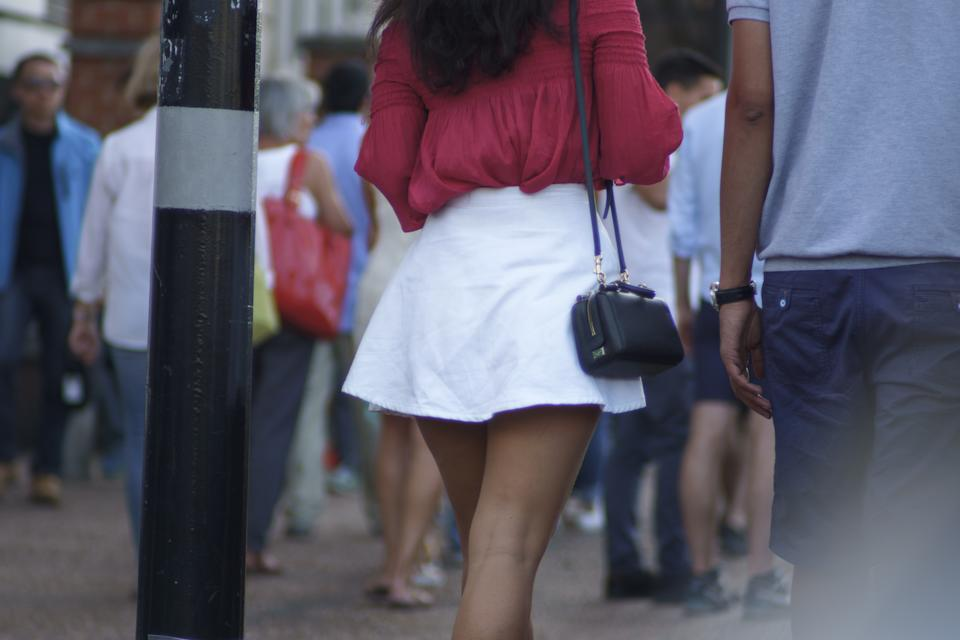 Woman in a skirt on the street.