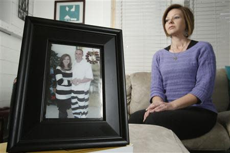 Kelly Muscolino, whose husband Mike is a prisoner serving 20 years for armed robbery, poses in front of a photo of the two of them at their home in Philadelphia