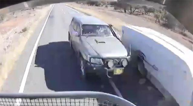 The overtaking vehicle came within just inches of the other four-wheel drive and the b-double, narrowly avoiding collision. Photo: Facebook / Dash Cam Owners Australia