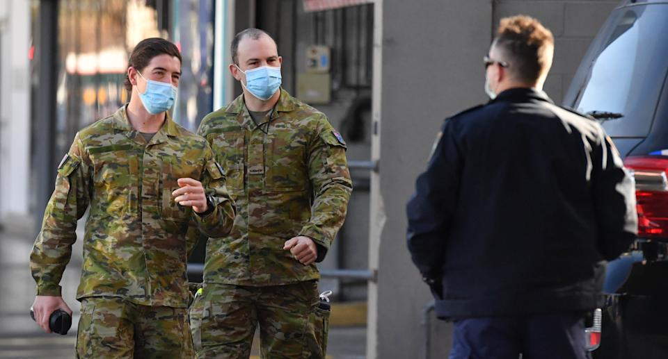 Australian Defence Force personnel and NSW police are seen at Fairfield in the south west suburb of Sydney, Monday, August 2, 2021. 300 ADF troops will reinforce the efforts of police, patrolling and door-knocking to ensure people are complying with coronavirus restrictions. Source: AAP