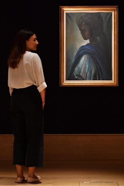 "Ben Enwonwu's ""Tutu"" painting is expected to fetch up to £300,000 (417,000 USD) at auction (AFP Photo/BEN STANSALL)"