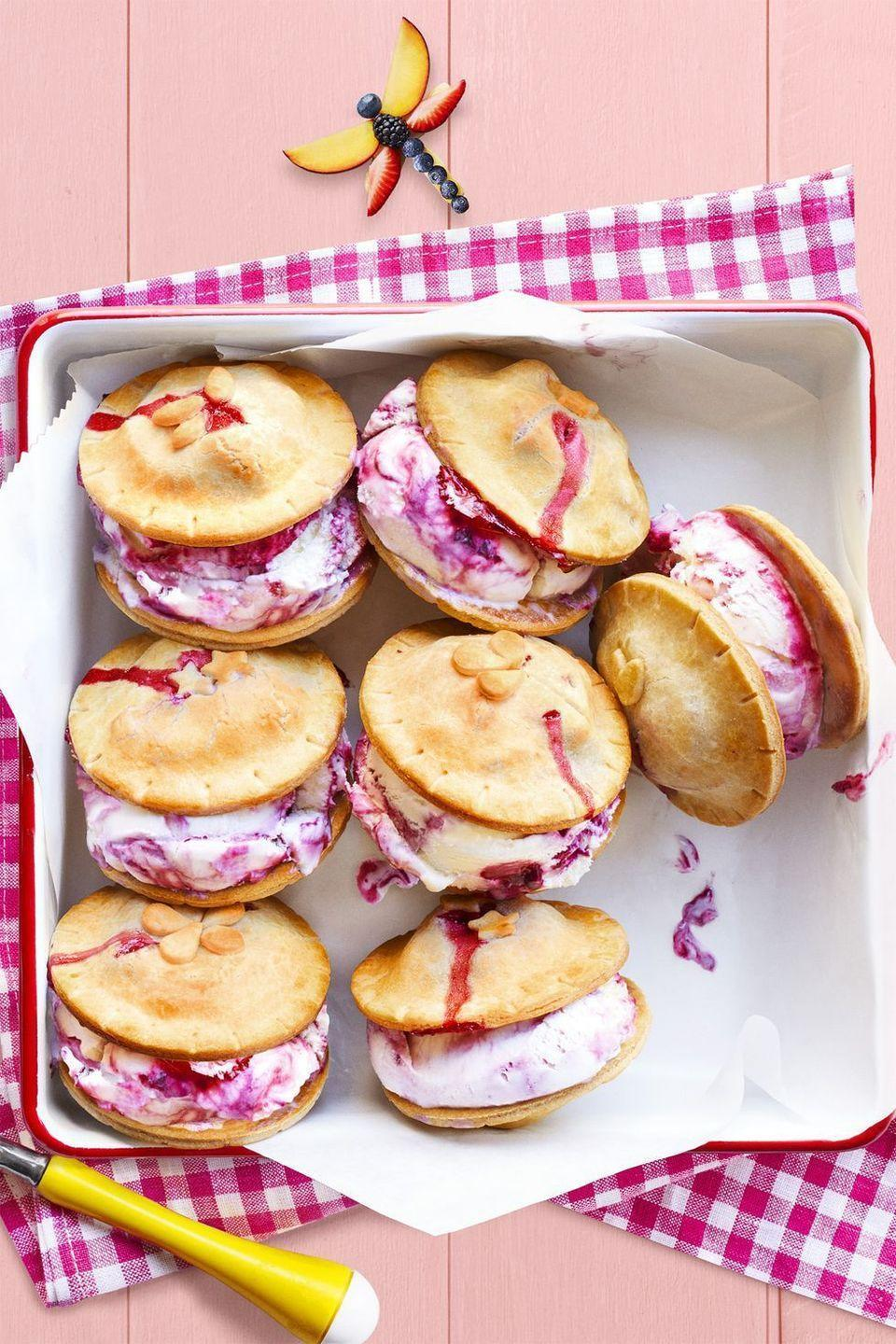 """<p>Ice cream sandwiches meet pie à la mode with these tasty summer bites.</p><p><strong><em><a href=""""https://www.womansday.com/food-recipes/food-drinks/recipes/a59001/fresh-berry-ice-cream-piewiches-recipe/"""" rel=""""nofollow noopener"""" target=""""_blank"""" data-ylk=""""slk:Get the Fresh Berry Ice Cream Piewiches recipe."""" class=""""link rapid-noclick-resp"""">Get the Fresh Berry Ice Cream Piewiches recipe. </a></em></strong><br></p>"""