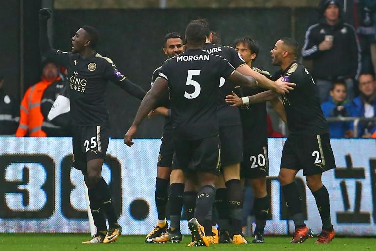 Leicester City striker Shinji Okazaki (2nd R) celebrates with teammates after scoring his second goal against Swansea at The Liberty Stadium in Swansea, south Wales on October 21, 2017