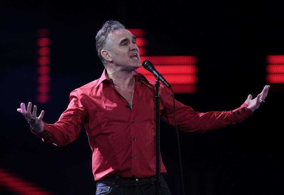 """FILE - In this Friday, Feb. 24, 2012 file photo, England's singer Morrissey performs at the 53rd annual Vina del Mar International Song Festival in Vina del Mar, Chile. Animal rights activist and singer Morrissey said he's canceled an appearance Tuesday, Feb. 26, 2013, on Jimmy Kimmel's talk show because cast members of A&E's """"Duck Dynasty"""" also were scheduled to appear. (AP Photo/Jorge Saenz, File)"""