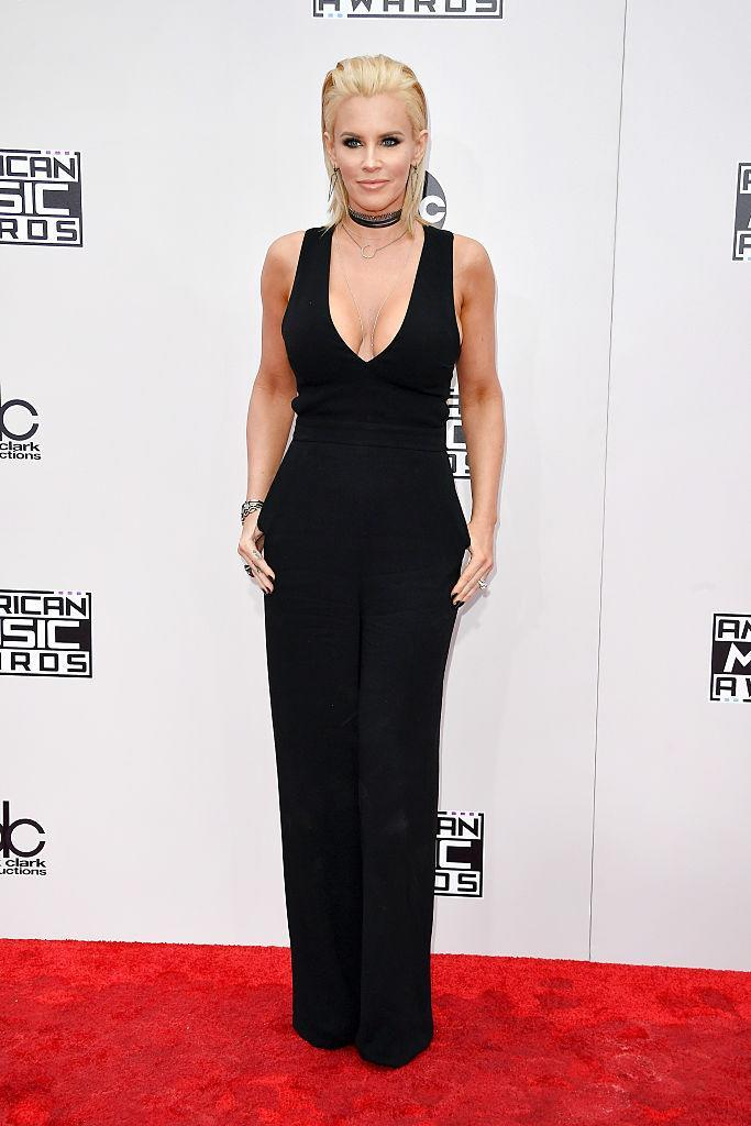 <p>Jenny McCarthy's simple black jumpsuit was made more festive with a very low neckline, choker necklace, and voluminous hairstyle. <em>(Photo: Getty Images)</em> </p>
