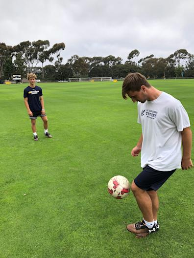 "Cooper Lachenbruch, left, a soccer player at the University of California San Diego, works out with teammate Cory Dailey while contemplating a ""new normalcy"" in higher education."