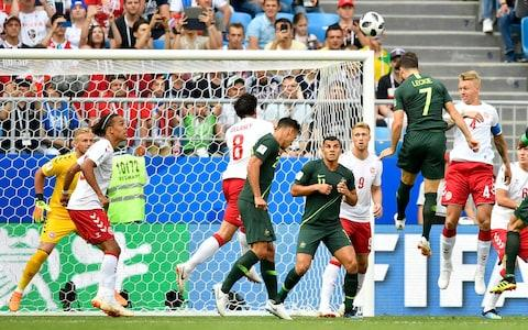 Australia's Mathew Leckie, 7, heads a ball on the goal during the group C match between Denmark and Australia at the 2018 soccer World Cup in the Samara Arena in Samara, Russia, Thursday, June 21, 2018 - Credit: AP