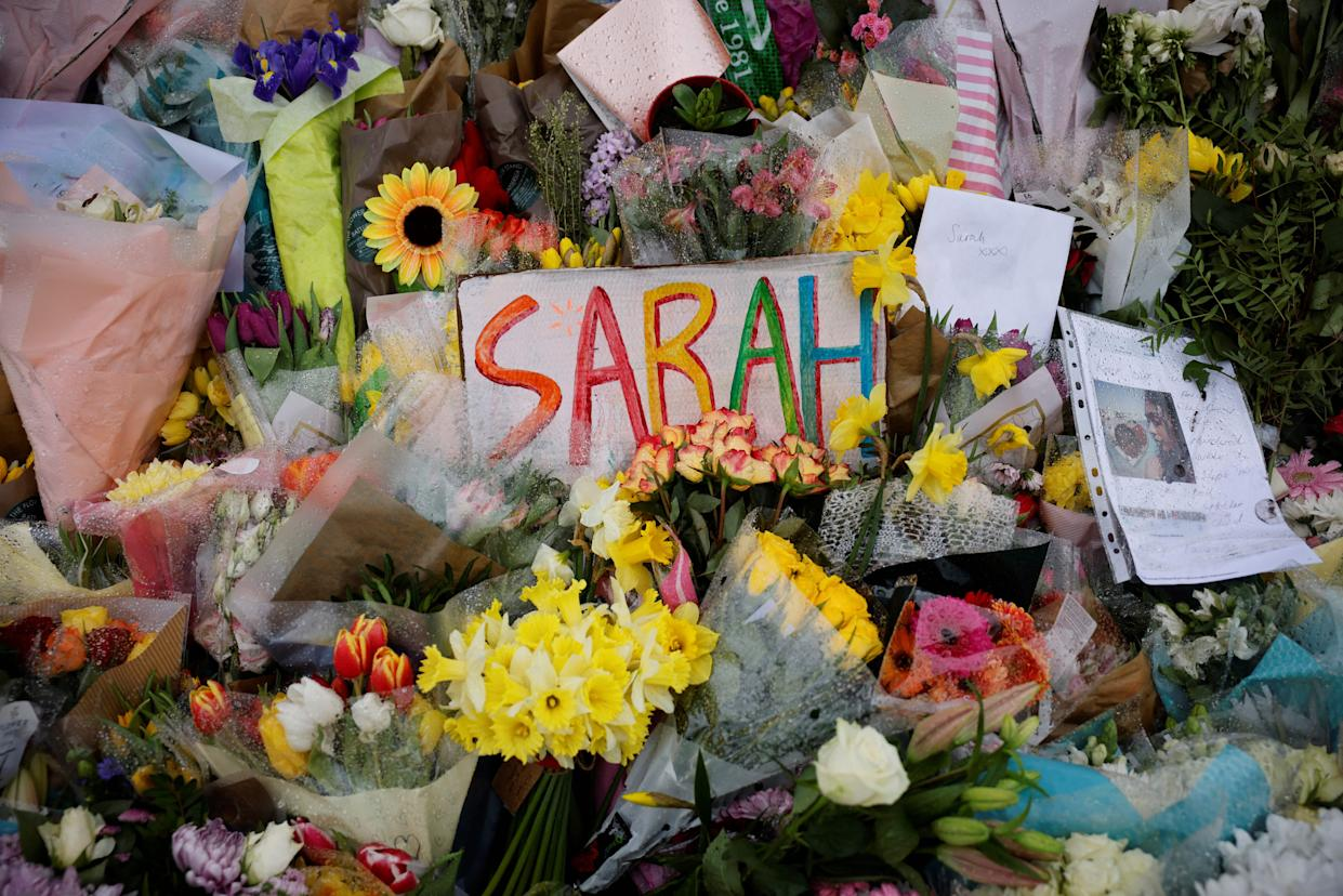 Floral tributes and messages in honour of Sarah Everard, the missing woman who's remains were found in woodland in Kent, are displayed at the bandstand on Clapham Common in south London on March 17, 2021. - Prime Minister Boris Johnson said Wednesday Britain needed