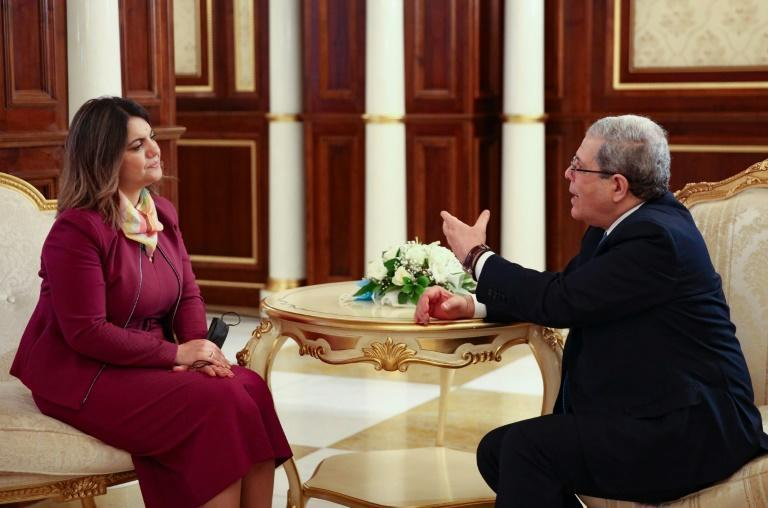 Libya's new Minister of Foreign Affairs Najla al-Mangoush (L) meets with her Tunisian counterpart Othman Jerandi, in the Libyan capital Tripoli, on March 17, 2021
