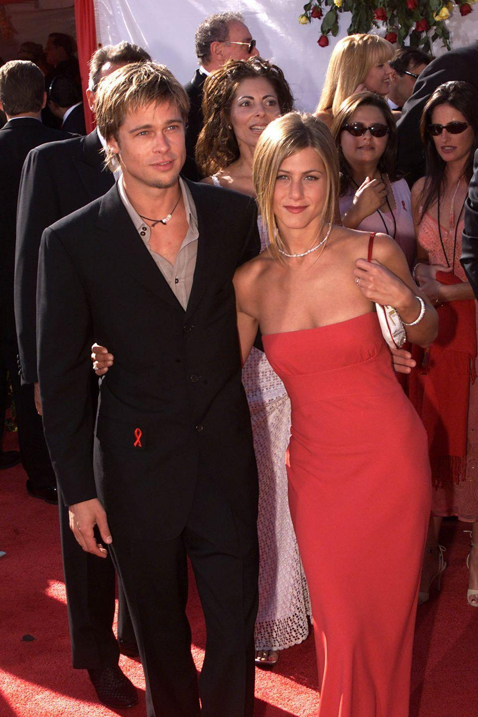 <p>Pitt and Aniston make another appearance at the Emmy Awards, this time as newlyweds (and looking classy AF, we might add). </p>