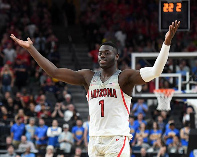 "<a class=""link rapid-noclick-resp"" href=""/ncaab/players/136216/"" data-ylk=""slk:Rawle Alkins"">Rawle Alkins</a> threw down a dunk worthy of the top spot on Sports Center's Top 10 in Arizona's Pac 12 tournament title game against USC on Saturday. (Getty Images)"
