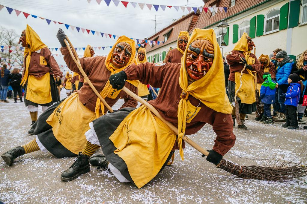 <p>Revelers dressed in traditional colorful costumes and painted, wooden masks take part in the annual Fasnet carnival parade on Feb. 4, 2018 in Oberdischingen, Germany. Carnival season in the Swabian-Alemanic region of southern Germany and German-speaking Switzerland is getting into gear with carnival parades taking place throughout the first few weeks of February. Fasnet has its roots in the Catholic tradition of fasting before Lent. Photo from Thomas Niedermueller/Getty Images. </p>