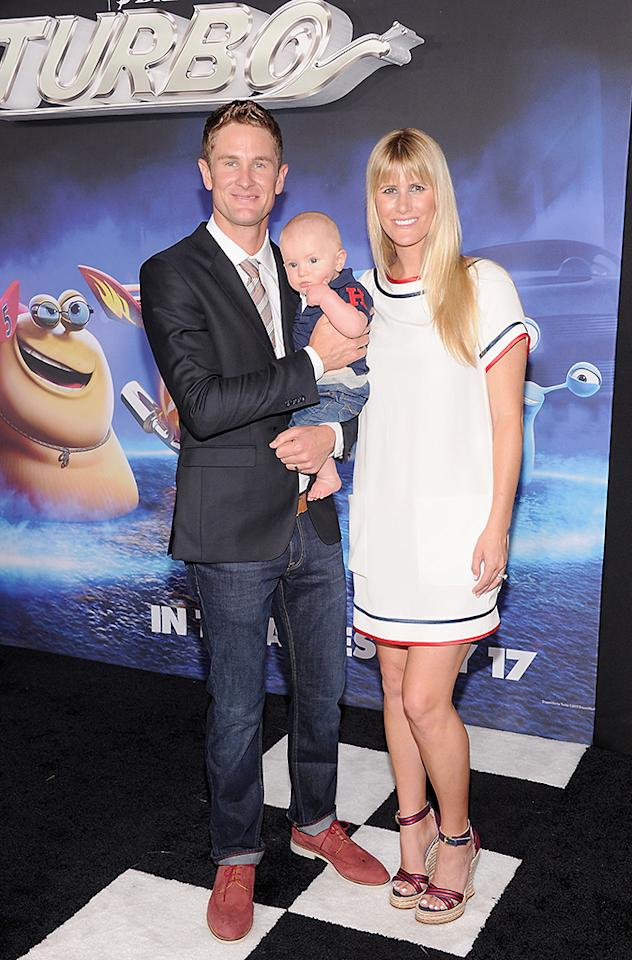 "NEW YORK, NY - JULY 09:  IndyCar Driver Ryan Hunter-Reay with his son Ryden  Hunter-Reay and wife Beccy Hunter-Reay attend the ""Turbo"" New York Premiere at AMC Loews Lincoln Square on July 9, 2013 in New York City.  (Photo by Jamie McCarthy/WireImage)"
