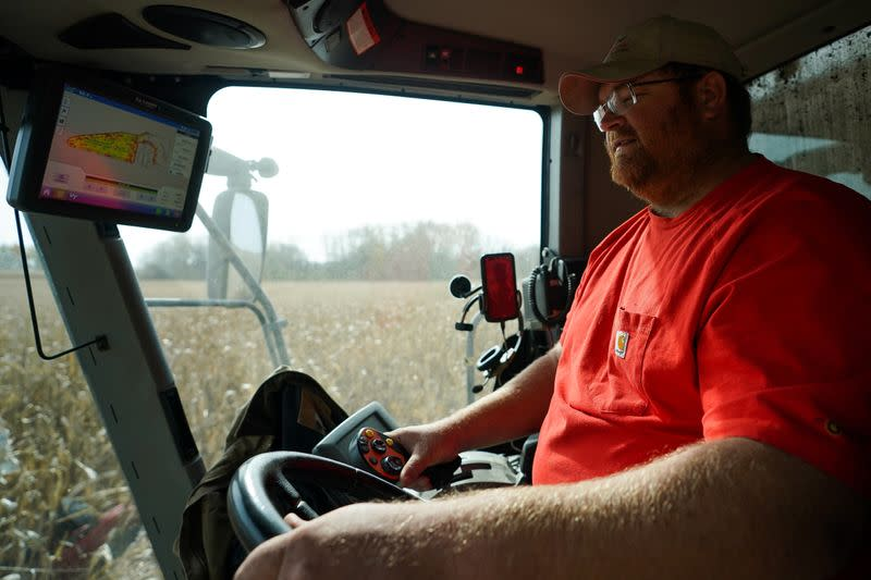 Paul Hodgen harvests corn from a field using a combine on his farm in Roachdale