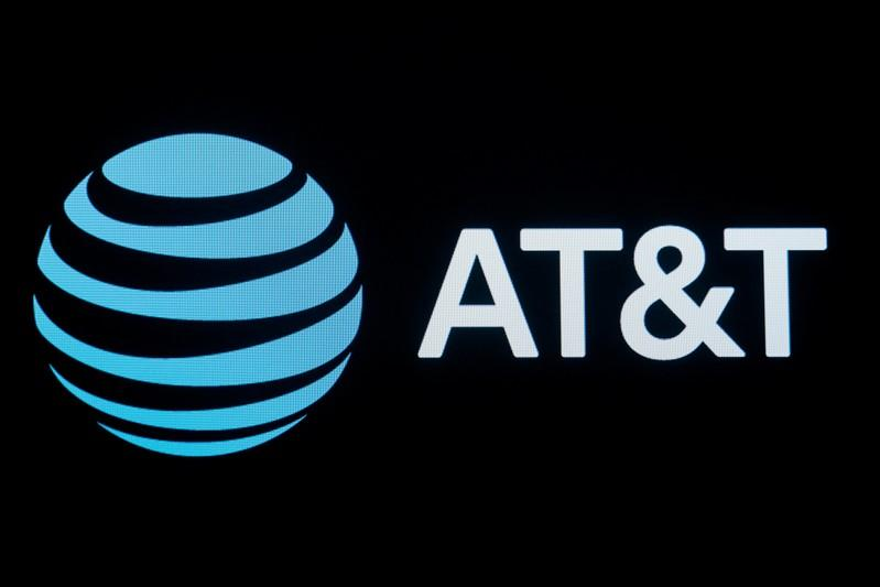 The company logo for AT&T is displayed on a screen on the floor at the New York Stock Exchange (NYSE) in New York