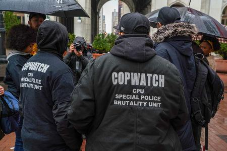 Cop Watch Patrol Unit arrives for the disciplinary trial of police officer Daniel Pantaleo in relation to the death of Eric Garner at 1 Police Plaza in the Manhattan borough of New York, New York, U.S., May 13, 2019. REUTERS/David 'Dee' Delgado