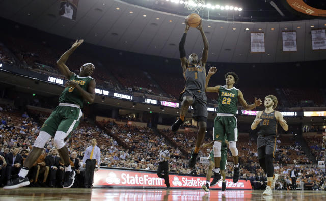 """Texas guard <a class=""""link rapid-noclick-resp"""" href=""""/ncaaf/players/242084/"""" data-ylk=""""slk:Andrew Jones"""">Andrew Jones</a> (1) drives to the basket past Florida A&M guard Marcus Barham (22) during the second half of an NCAA college basketball game, Wednesday, Nov. 29, 2017, in Austin, Texas. Texas won 82-58. (AP Photo/Eric Gay)"""