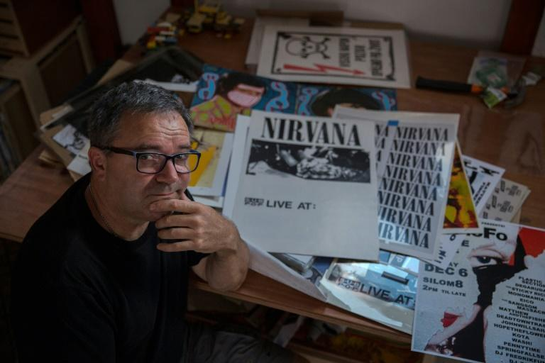 Ross made his name designing posters for Nirvana and other bands at the height of Seattle's grunge scene in the 1990s (AFP Photo/Vladimir Zivojinovic)