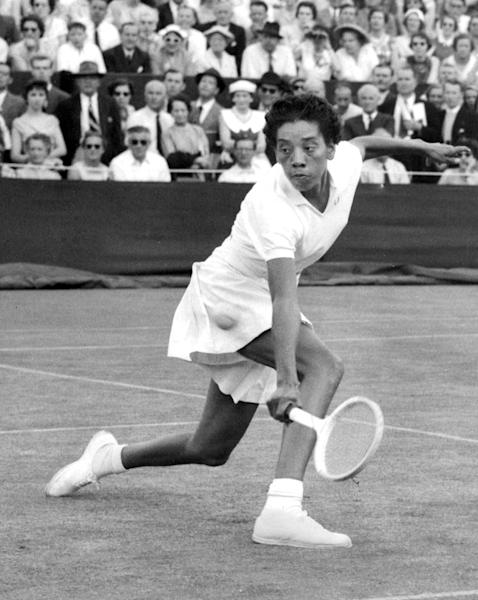 FILE - In this June 26, 1956 file photo, trailblazing tennis star Althea Gibson competes in the first round of Wimbledon, in England. Gibson, who went on to win the French Open, the U.S. Nationals and was named the Female Athlete of the Year in 1957 by The Associated Press, was among the more than a million black people who werenít counted in the 1940 census. There's no record of Gibson and her family in the decennial census, the records of which were released online to the public by the U.S. Census Bureau on April 2, 2012, after a 72-year confidentiality period lapsed. (AP Photo, File)
