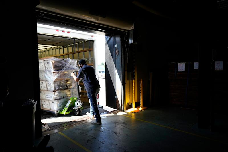 Absentee ballots are loaded onto a truck for mailing at the Wake County Board of Elections as election preparations are ongoing in Raleigh, North Carolina. (Photo: AP Photo/Gerry Broome)