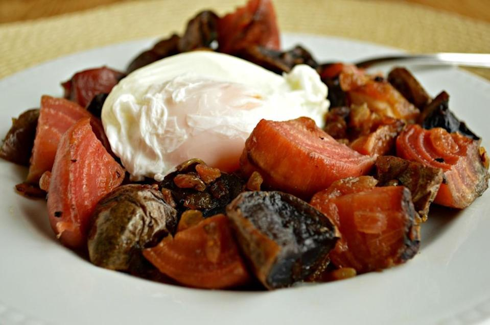 "<p>A New England diner star, red flannel hash gets its name from its bright red beets. Toss in your vegetable scraps and last night's dinner potatoes, then top it all with runny poached eggs.</p> <p><a href=""https://www.thedailymeal.com/best-recipes/red-flannel-hash-poached-egg-diner-brunch?referrer=yahoo&category=beauty_food&include_utm=1&utm_medium=referral&utm_source=yahoo&utm_campaign=feed"" rel=""nofollow noopener"" target=""_blank"" data-ylk=""slk:For the Red Flannel Hash with Poached Egg recipe, click here."" class=""link rapid-noclick-resp"">For the Red Flannel Hash with Poached Egg recipe, click here.</a></p>"