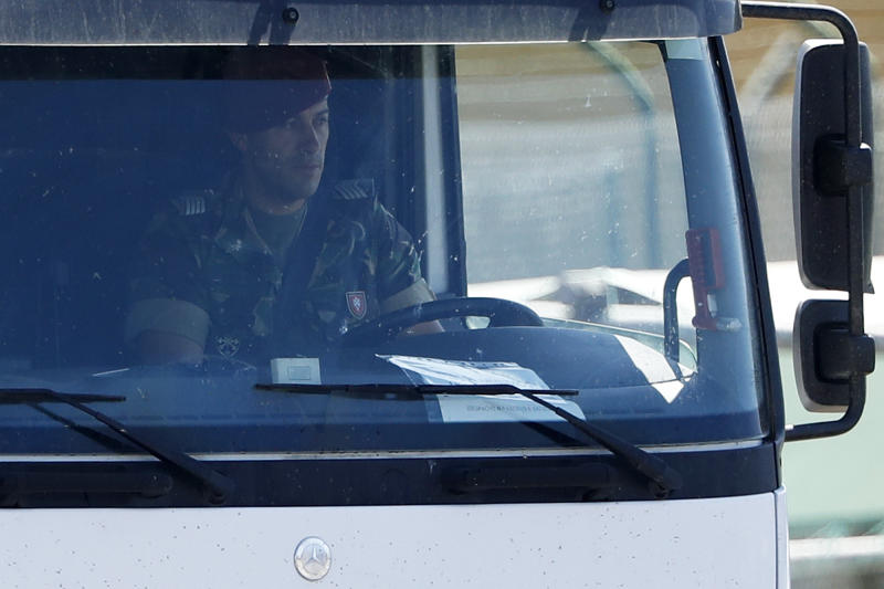 A soldier drives a jet fuel tanker truck at a fuel depot in Aveiras, outside Lisbon, Tuesday, Aug. 13, 2019. Soldiers are driving tanker trucks to distribute gas in Portugal as an open-ended truckers' strike over pay enters its second day. The government has issued an order allowing the army to be used. (AP Photo/Armando Franca)