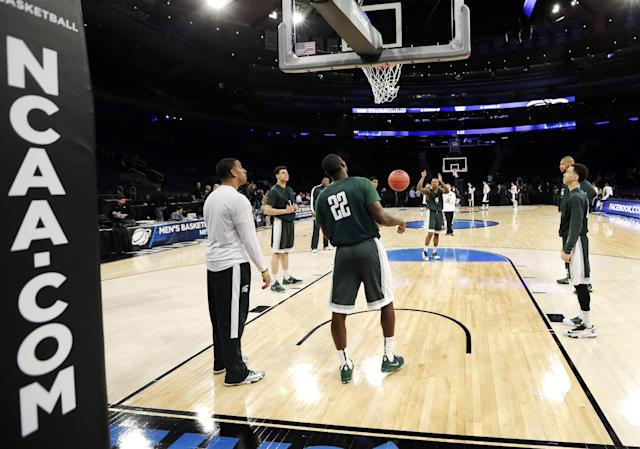 Michigan State players practice at Madison Square Garden at the NCAA college basketball tournament in New York, Thursday, March 27, 2014. Michigan State plays Virginia in a regional semifinal on Friday. (AP Photo/Frank Franklin)